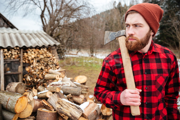Serious lumberjack holding axe Stock photo © deandrobot