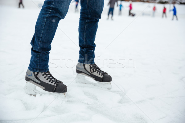 Man's legs in ice skates Stock photo © deandrobot
