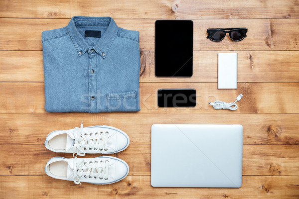 Travel concept shoes, shirt, mobile phone, laptop,mp3, usb, eyeg Stock photo © deandrobot