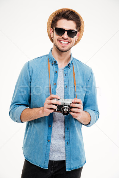 Stock photo: Happy man in hat and sunglasses with old photo camera