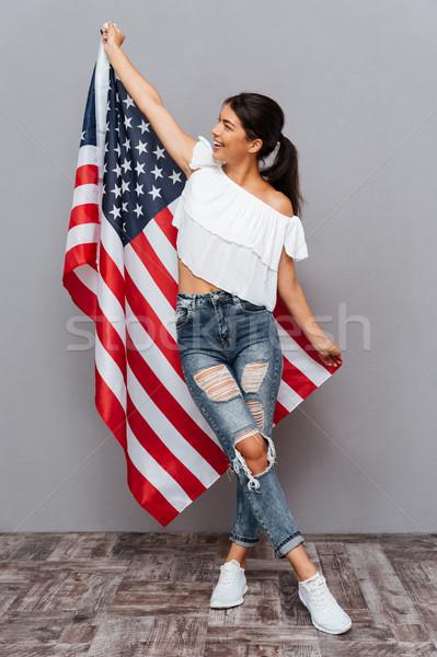 Mutlu genç kız ABD bayrak yalıtılmış Stok fotoğraf © deandrobot