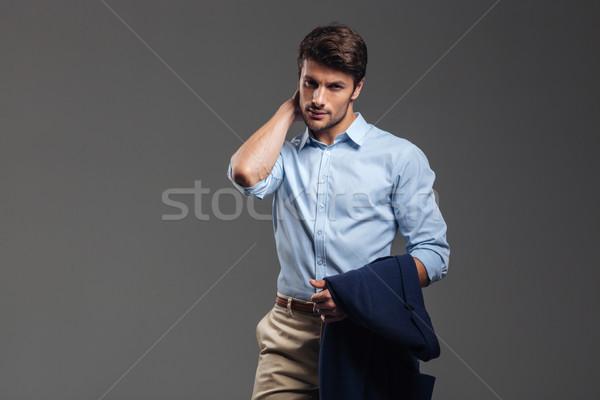 Ritratto giovani imprenditore dolore al collo giacca Foto d'archivio © deandrobot