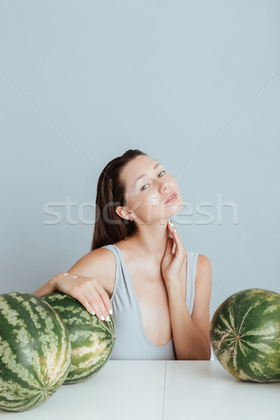 Portrait of sensual young woman with fresh watermelons Stock photo © deandrobot