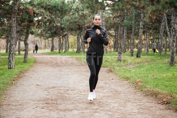 Vrolijk dame runner warm kleding najaar Stockfoto © deandrobot