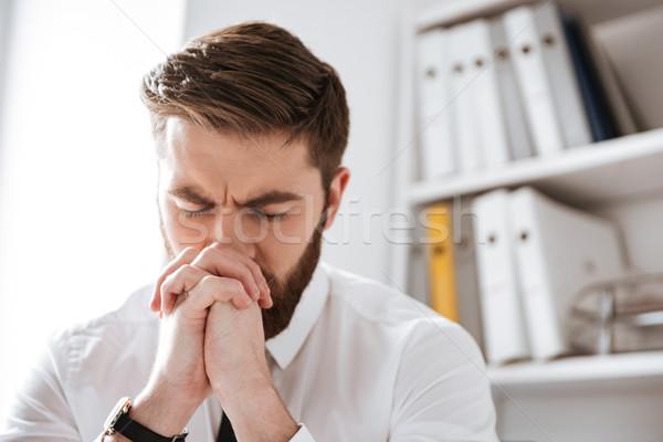 Koncentrált fiatal üzletember ül iroda kép Stock fotó © deandrobot