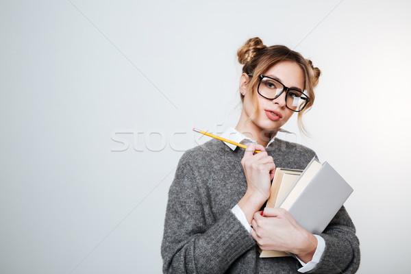 Mooie vrouw trui bril boeken potlood poseren Stockfoto © deandrobot