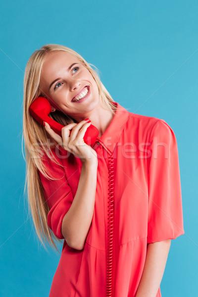 Gülen kız kırmızı elbise konuşma Retro Stok fotoğraf © deandrobot