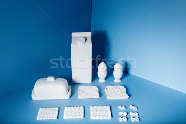White milk pack, eggs, butter, apple, cookies and pasta bow Stock photo © deandrobot