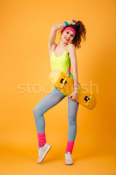 Teljes alakos derűs fiatal sportoló áll tart Stock fotó © deandrobot