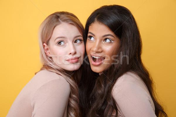 Genç iki kadınlar ayakta sarı Stok fotoğraf © deandrobot
