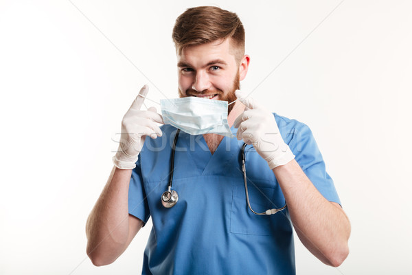 Genç erkek tıbbi doktor hemşire steril Stok fotoğraf © deandrobot