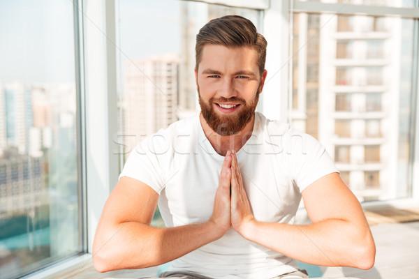 Szakállas férfi meditáció ablak otthon ház Stock fotó © deandrobot