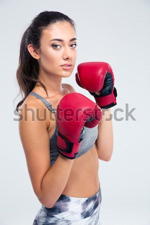 Naked woman in boxing gloves Stock photo © deandrobot