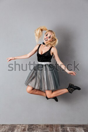 Full length portrait of a cheerful crazy blonde woman Stock photo © deandrobot