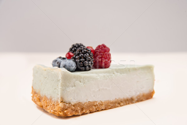 Side view of blue cheesecake with different berries Stock photo © deandrobot