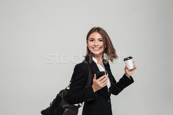 肖像 満足した 女性 スーツ 携帯電話 ストックフォト © deandrobot