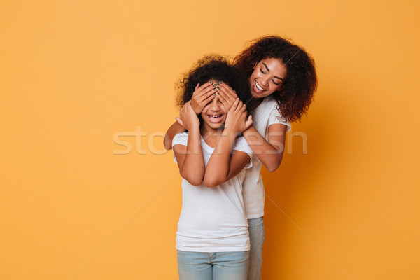 Two happy afro american sisters having fun Stock photo © deandrobot