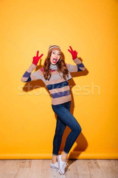 Full length portrait of cheery girl Stock photo © deandrobot