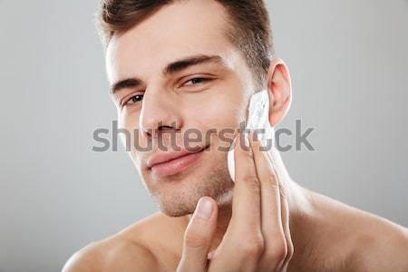 Portrait souriant homme cheveux doigts Photo stock © deandrobot