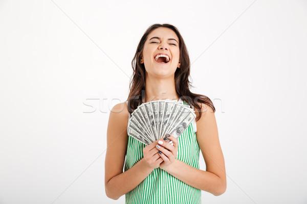 Portré elégedett lány ruha tart köteg Stock fotó © deandrobot
