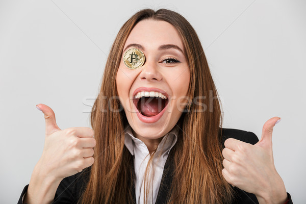 Portrait of a delighted businesswoman Stock photo © deandrobot
