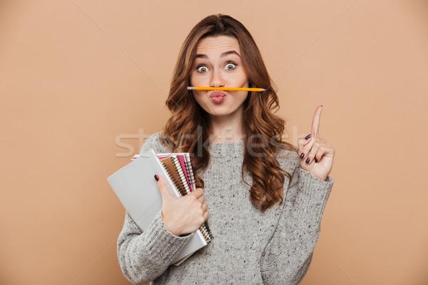 смешные Привлекательная женщина студент карандашом носа губ Сток-фото © deandrobot