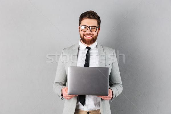 肖像 笑みを浮かべて ビジネスマン スーツ 眼鏡 ストックフォト © deandrobot