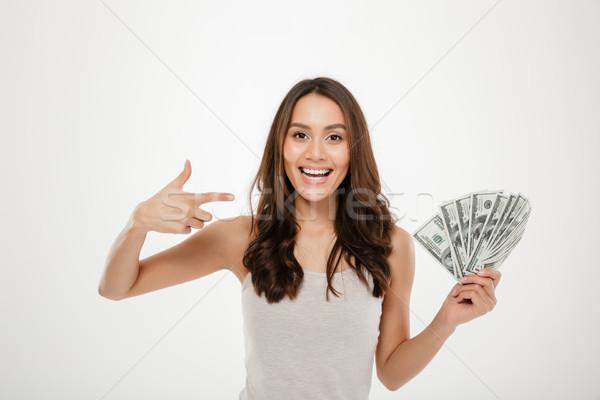 Ritratto di successo capelli lunghi soldi Foto d'archivio © deandrobot