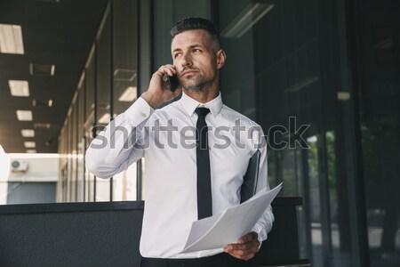 Portré töprengő fiatal üzletember hivatalos ruházat Stock fotó © deandrobot