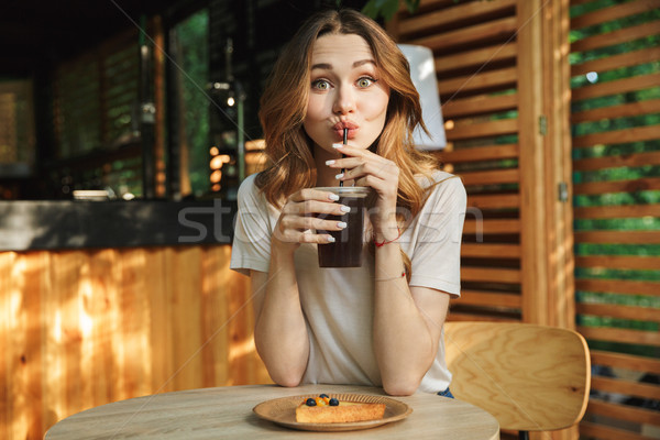 Portrait of a smiling young girl drinking lemonade Stock photo © deandrobot