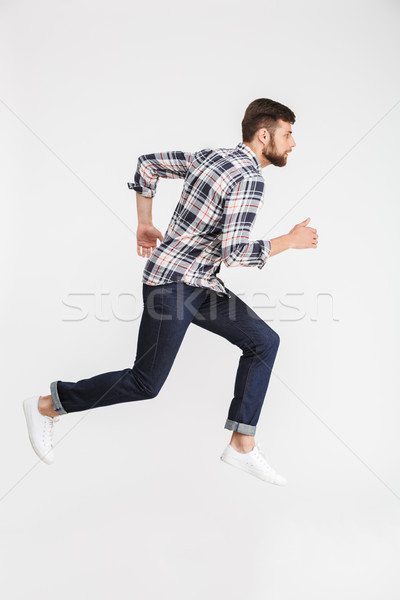 Full length portrait of a casual young man in shirt Stock photo © deandrobot