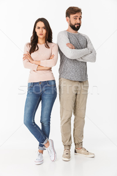 Displeased young loving couple quarrel. Stock photo © deandrobot