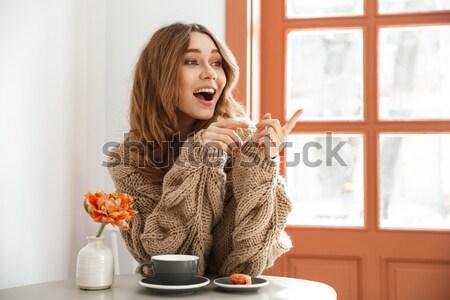 Portré izgatott nő pulóver hosszú barna haj Stock fotó © deandrobot