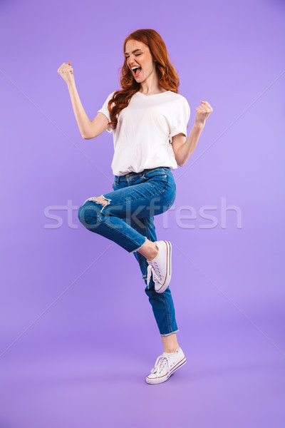Full length portrait of a cheerful young girl Stock photo © deandrobot
