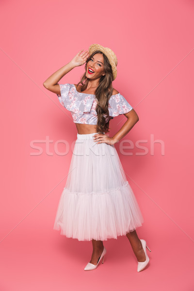Full length portrait of glamorous european woman 20s wearing str Stock photo © deandrobot