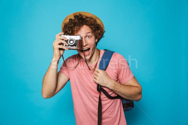 Imagem atraente turista homem cabelos cacheados Foto stock © deandrobot