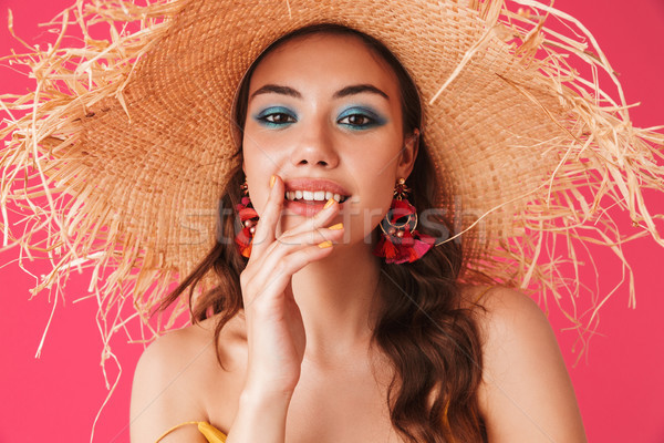 Image closeup of glamorous caucasian woman 20s wearing big straw Stock photo © deandrobot