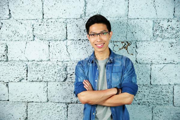 肖像 トレンディー 笑みを浮かべて アジア 男 ストックフォト © deandrobot