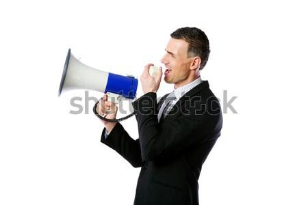Portrait of businessman shouting through megaphone isolated on white background Stock photo © deandrobot