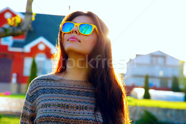Portrait of a pensive woman in trendy sunglasses Stock photo © deandrobot