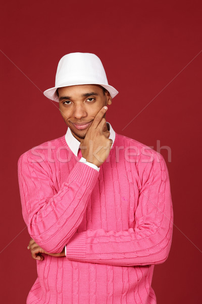 Young trendy african-american man on red background Stock photo © deandrobot