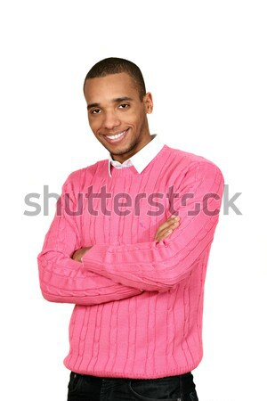 Young african-american man in pink sweater isolated over white background Stock photo © deandrobot