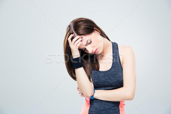 Fitness woman having headache Stock photo © deandrobot