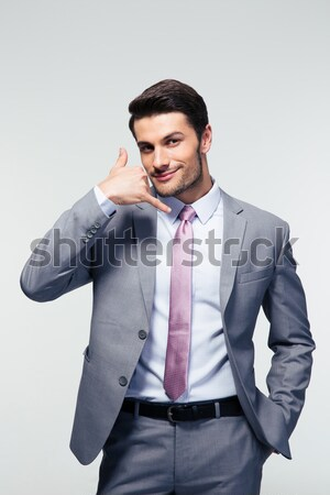 Happy businessman talking on the mobile phone Stock photo © deandrobot