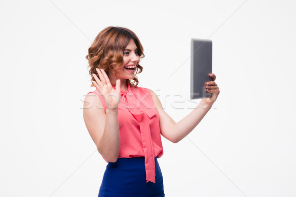 Nő készít üdvözlet kézmozdulat táblagép lezser Stock fotó © deandrobot