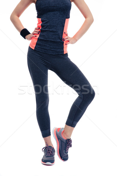 Closeup image of a woman`s fitness body Stock photo © deandrobot