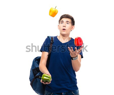 Casual young man juggles with pepper Stock photo © deandrobot