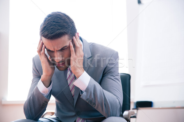 задумчивый бизнесмен сидят офисные кресла служба мужчин Сток-фото © deandrobot