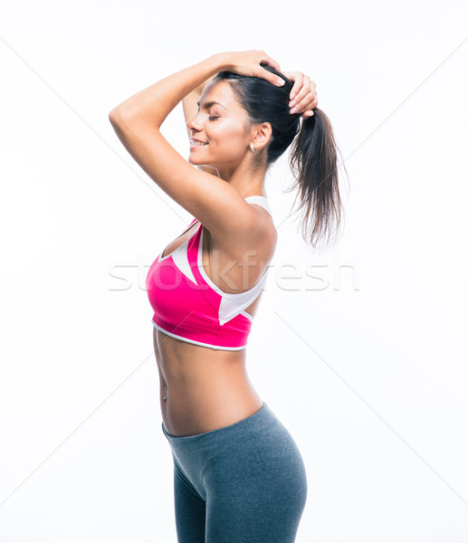 Woman holding her hair in ponytail Stock photo © deandrobot