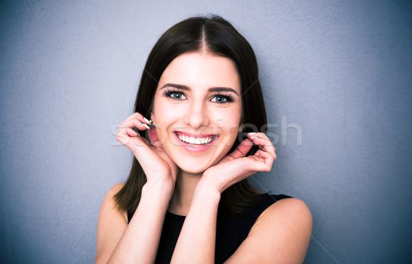 幸せ 女性 触れる イヤリング 肖像 笑みを浮かべて ストックフォト © deandrobot